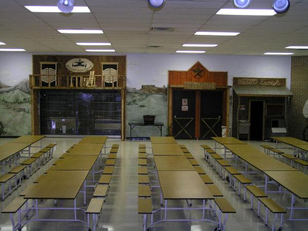 school cafeteria To improve the health of schoolchildren, cafeteria food has become the target in programs designed to improve school lunches, making them healthier.